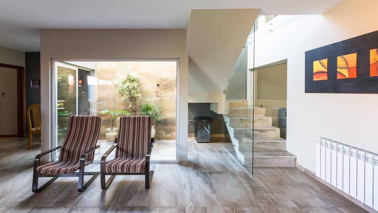 Modern Conservatory by KARLEN + CLEMENTE ARQUITECTOS Modern Glass
