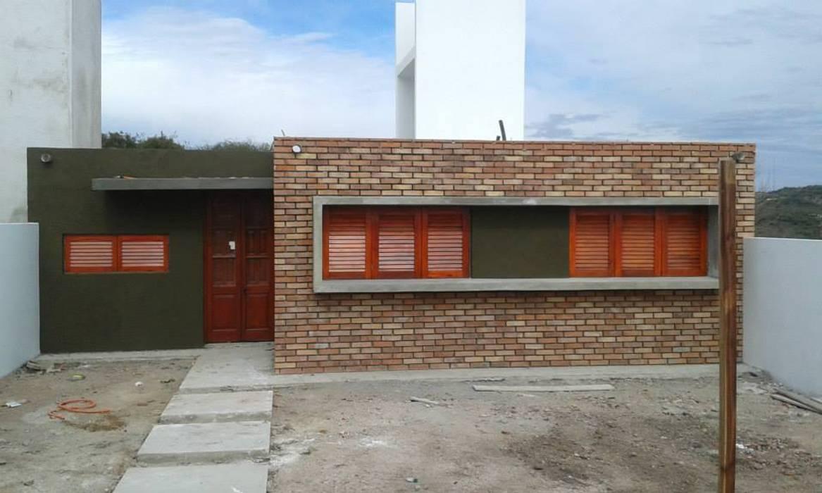 Casas de estilo  por Q R Arquitectura, Rural Ladrillos