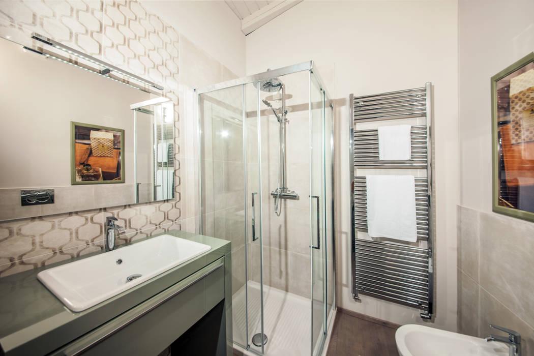 Semplicità delle forme e fotografia a colori: Hotel in stile  di STUDIO PAOLA FAVRETTO SAGL - INTERIOR DESIGNER