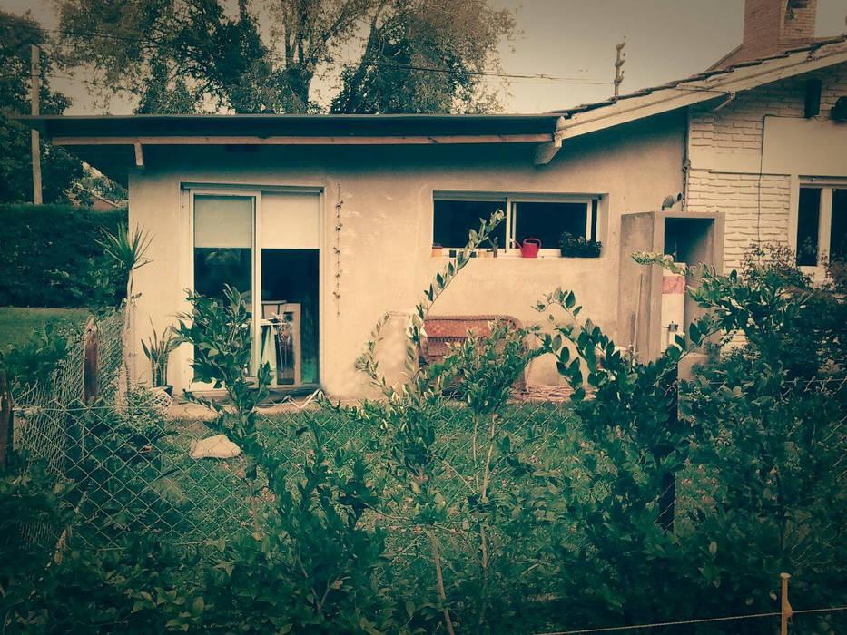 contrafachada : Casas de estilo  por Estudio ZP,Clásico Ladrillos