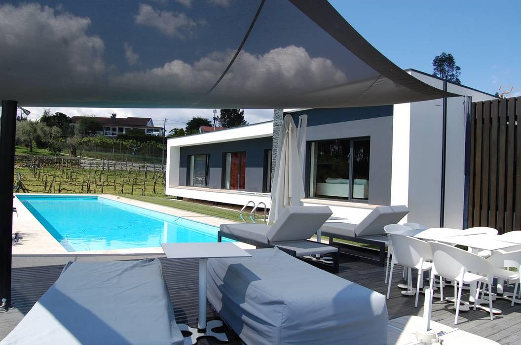 Casa da Vinha: Casas  por Engebasto - Atividades de Engenharia e Arquitetura, Lda,