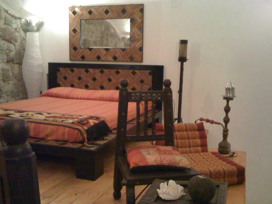 Ambienti etnici: camera da letto in stile di cesario ...