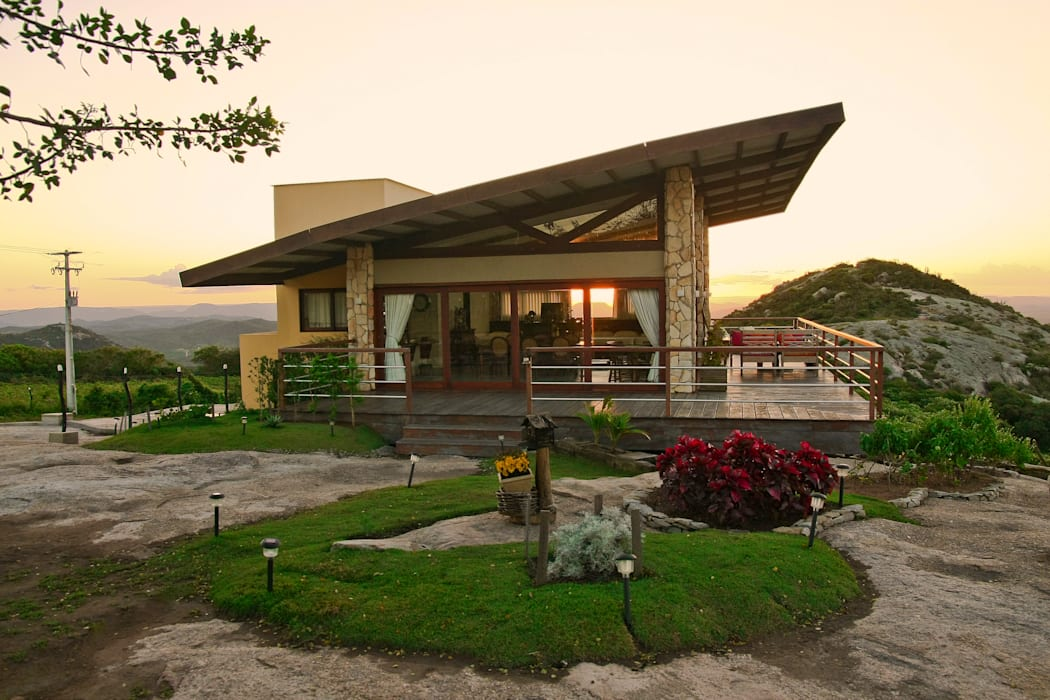 Duo Arquitetura Country style house Wood Beige
