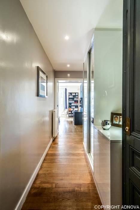 Entrée dressing: Couloir et hall d'entrée de style  par ADNOVA