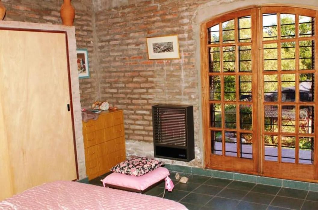 Dormitorio: Dormitorios de estilo  por Liliana almada Propiedades