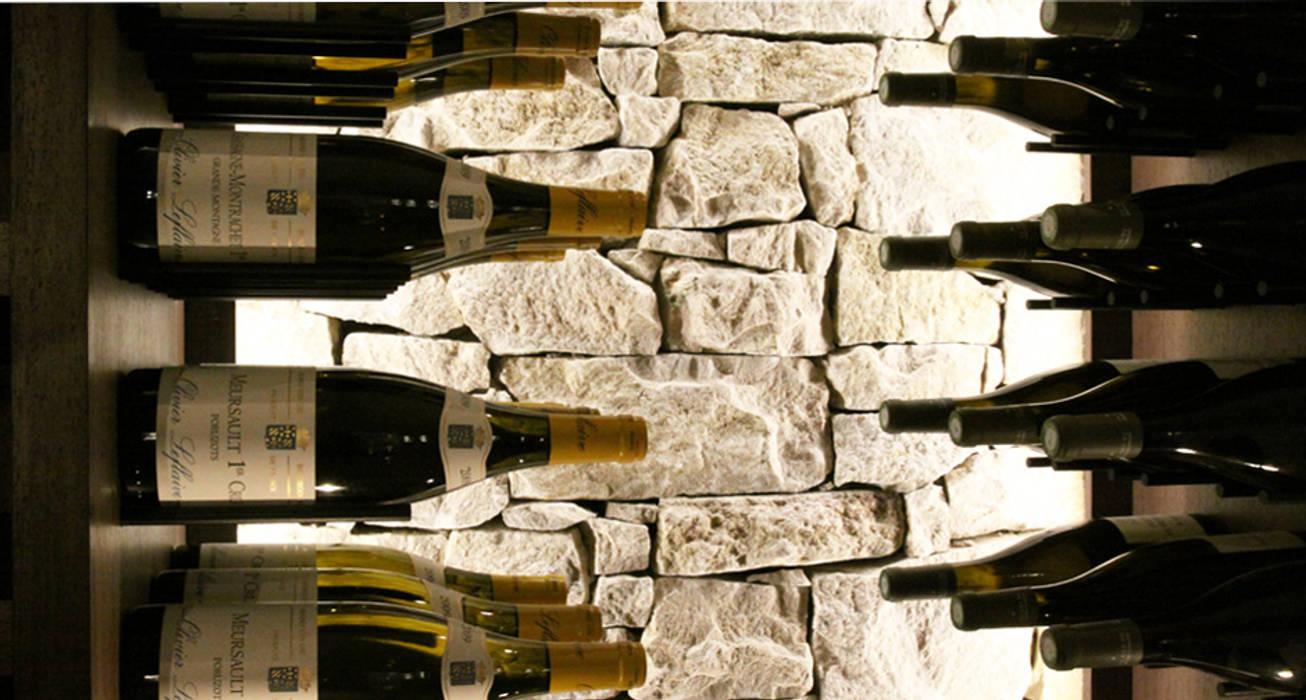 Cave à vin sur mesure en wengé et pierres sèches - Aix 2015: Cave à vin de style  par Degré 12