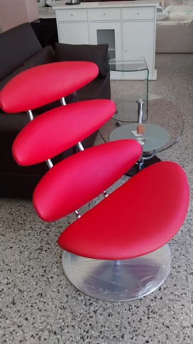 Salones de estilo  de Disegnos Muebles