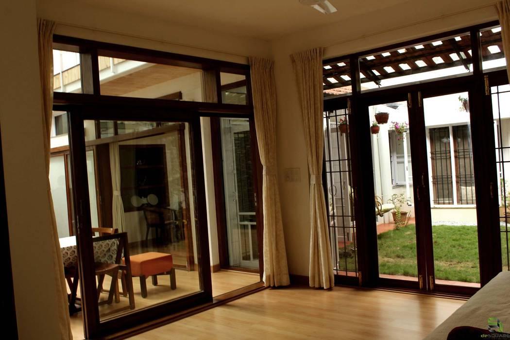 Puertas y ventanas de estilo tropical de de square Tropical
