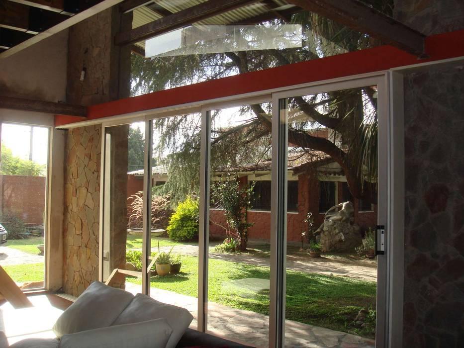 DESDE EL INTERIOR: Jardines de invierno de estilo  por Arq Andrea Mei   - C O M E I -,Moderno