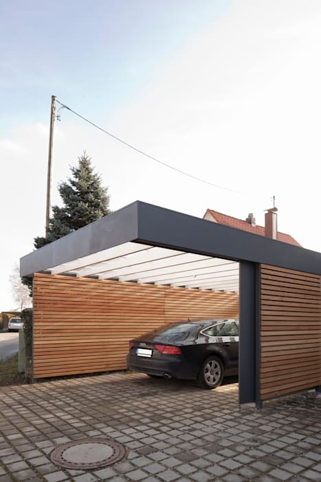 Garagens e arrecadações modernas por Architekt Armin Hägele Moderno