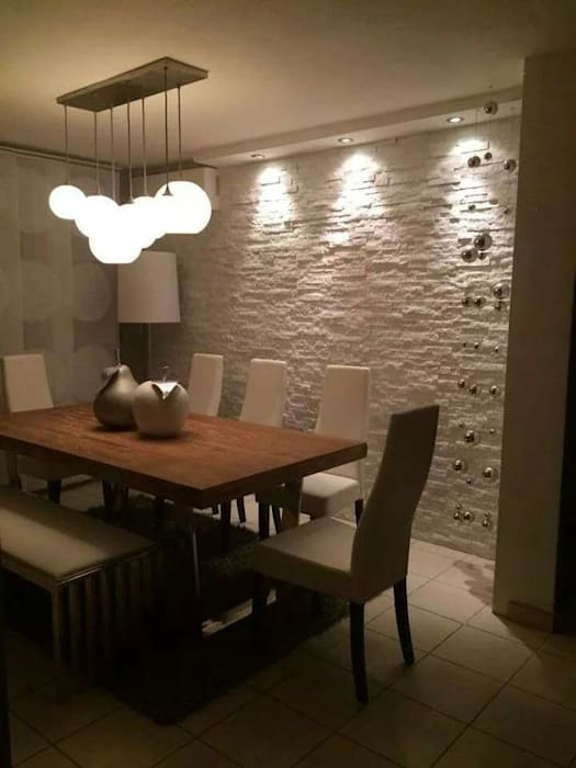 Dining room by Spazio3Design, Modern