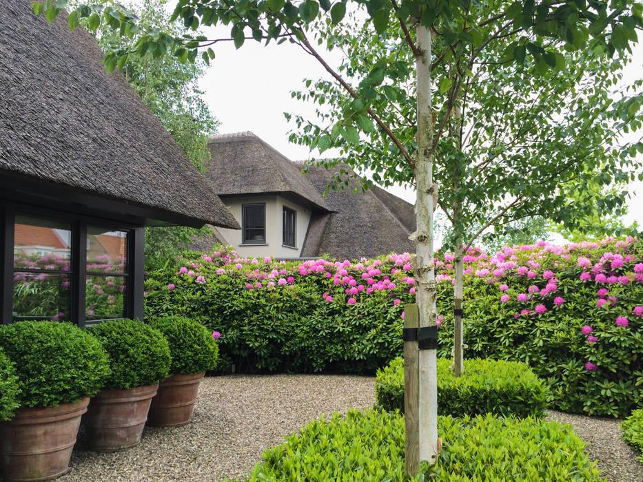 Tuin aan de plas:  Tuin door Vosselman Buiten