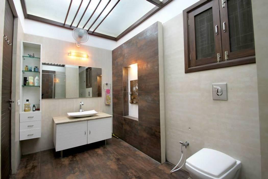 Wash room: modern Bathroom by Interior Shapes & Designs