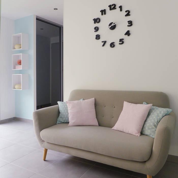 Une entrée accueillante.: Couloir et hall d'entrée de style  par Skéa Designer