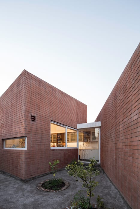 Vista Exterior Huerta_ Cocina: Casas de estilo  por Swett Arquitectos