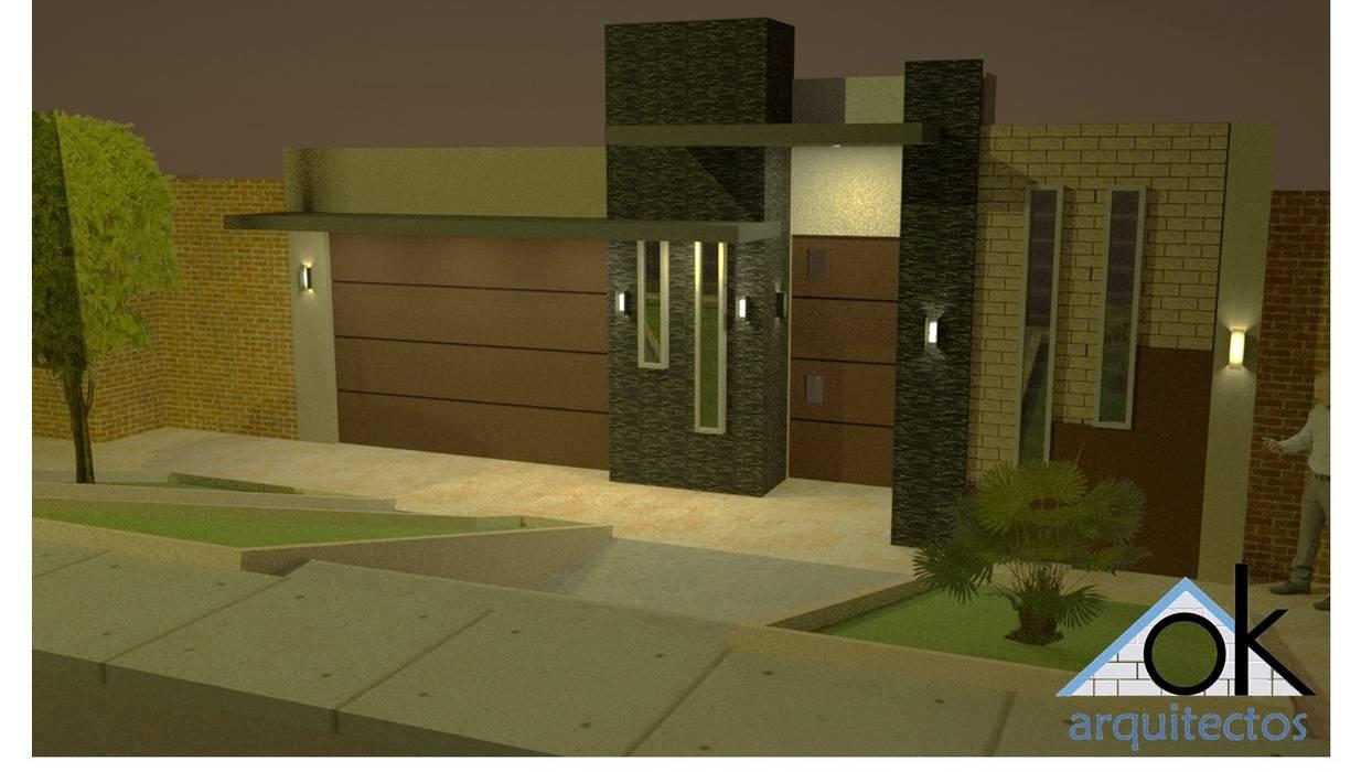 Fachadas Okarq vista de noche: Casas de estilo  por Okarq