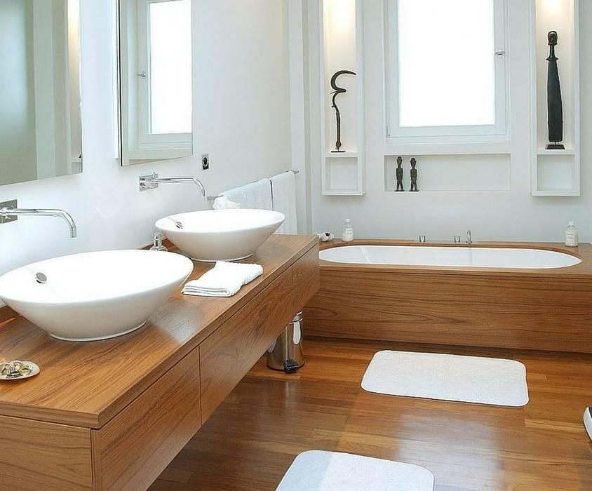 A madeira! Casas de banho modernas por homify Moderno Madeira Acabamento em madeira