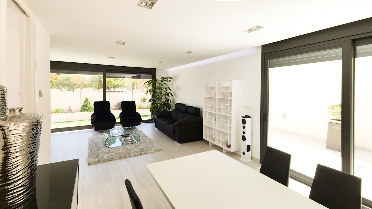 Living room by arqubo arquitectos, Modern Ceramic