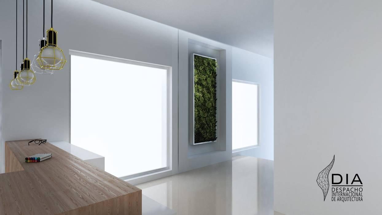 Muro Verde: Oficinas y tiendas de estilo  por DIIA,