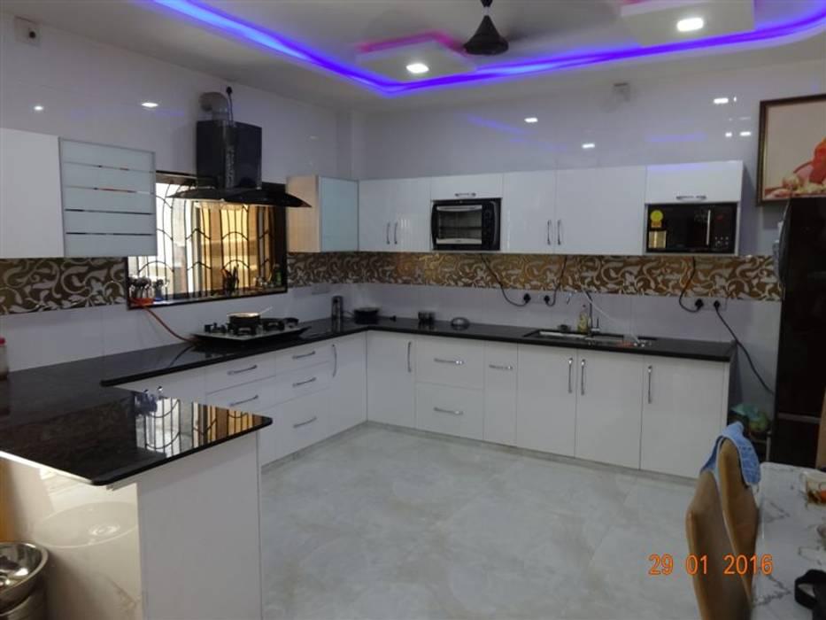 high gloss white hdf material  :  Kitchen by aashita modular kitchen