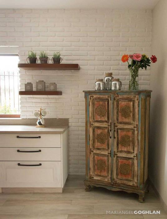 Modern style kitchen by MARIANGEL COGHLAN Modern