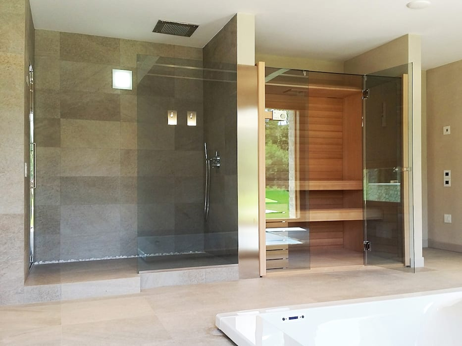 Area spa con cabina sauna e bagno turco di Effegibi Stefano Zaghini Architetto Spa in stile rurale
