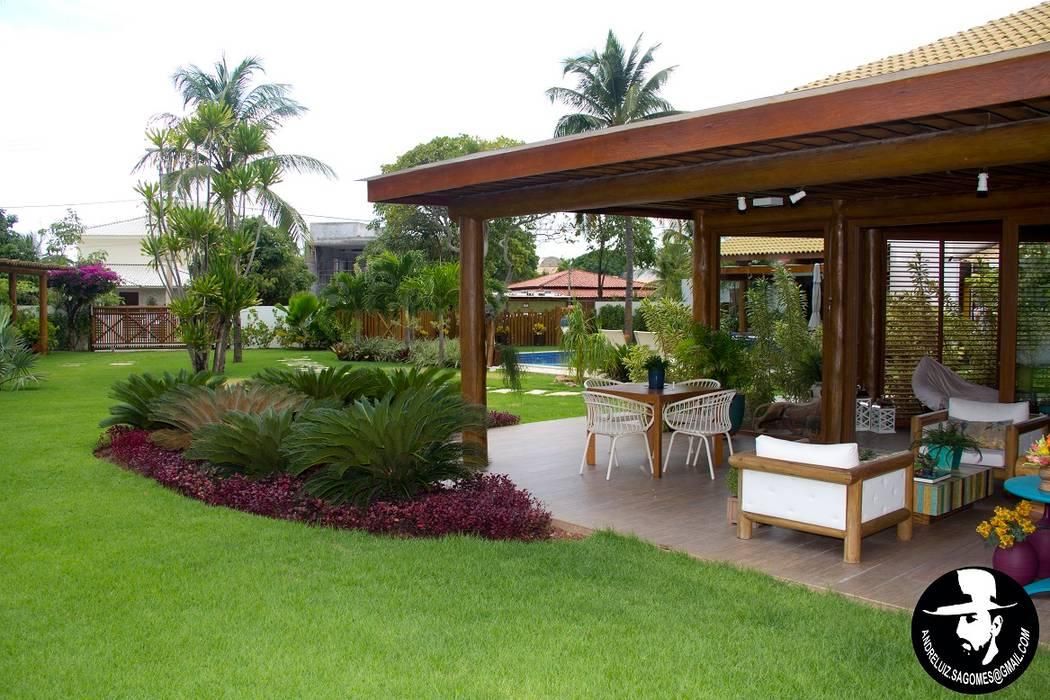 Tropical style houses by Tânia Póvoa Arquitetura e Decoração Tropical