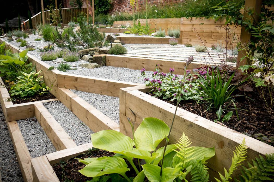 Modern Garden with a rustic twist:  Garden by Yorkshire Gardens