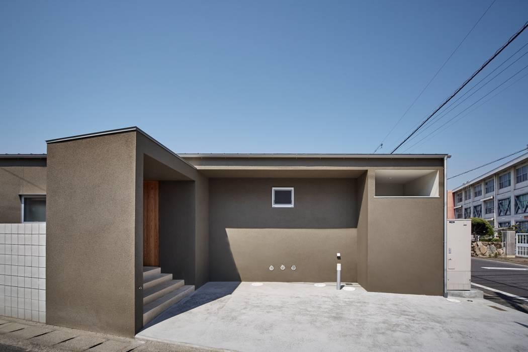 Дома в стиле минимализм от toki Architect design office Минимализм Дерево Эффект древесины