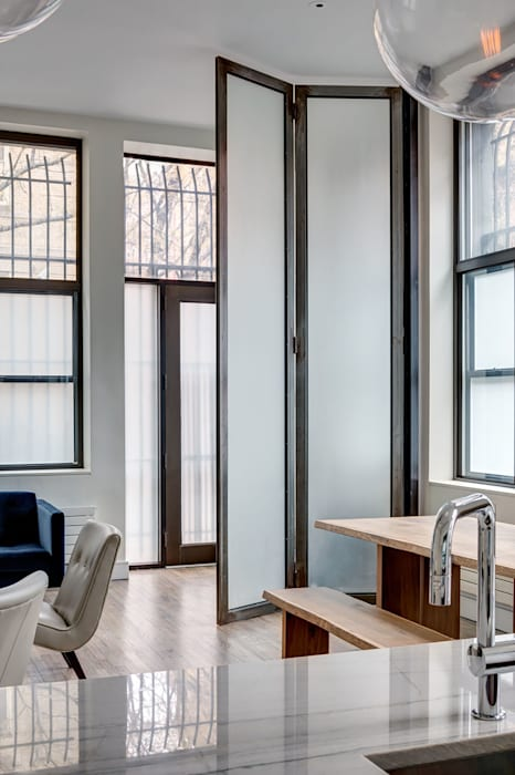 Interior of Duplex at Street Entry Level Modern Living Room by Lilian H. Weinreich Architects Modern Iron/Steel