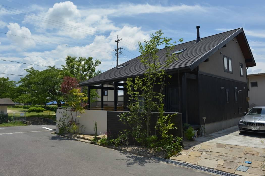 T's Garden Square Co.,Ltd. Casas modernas Madera