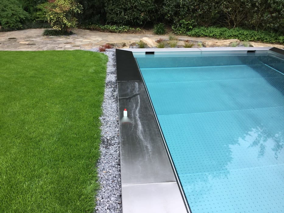Fertigstellung der Gartenarbeiten:  Pool von Hesselbach GmbH