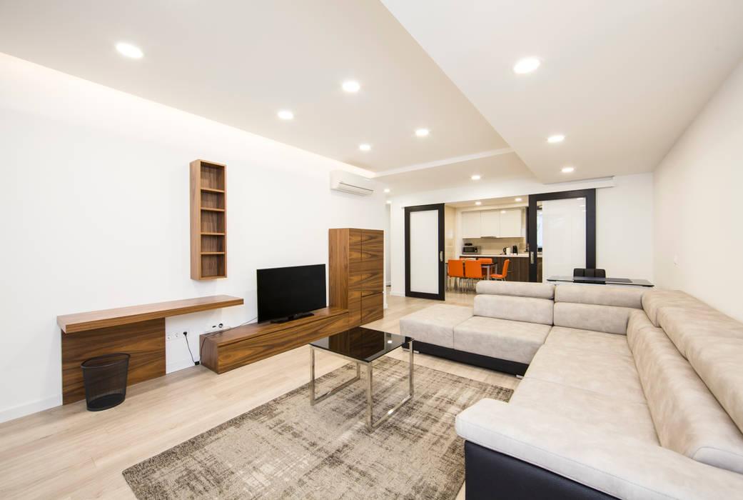 Sala : Salas de estar  por X|A - Arquitetura e Turismo, Lda