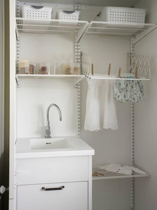 Lavadero y tendedero Cocinas de estilo rústico de DEULONDER arquitectura domestica Rústico