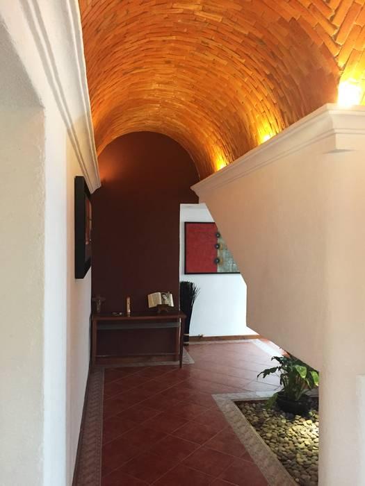 Modern Corridor, Hallway and Staircase by AMG Arquitectura Integral Modern Bricks