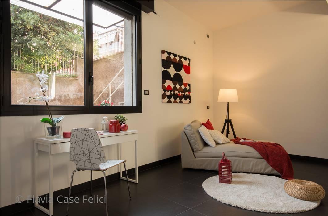 Salas modernas de Flavia Case Felici Moderno