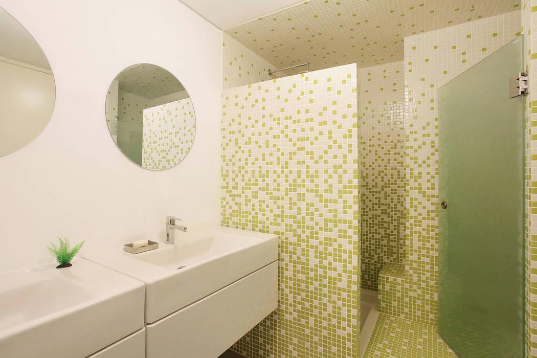 Remodelação T5 Picoas: Casas de banho  por BL Design Arquitectura e Interiores