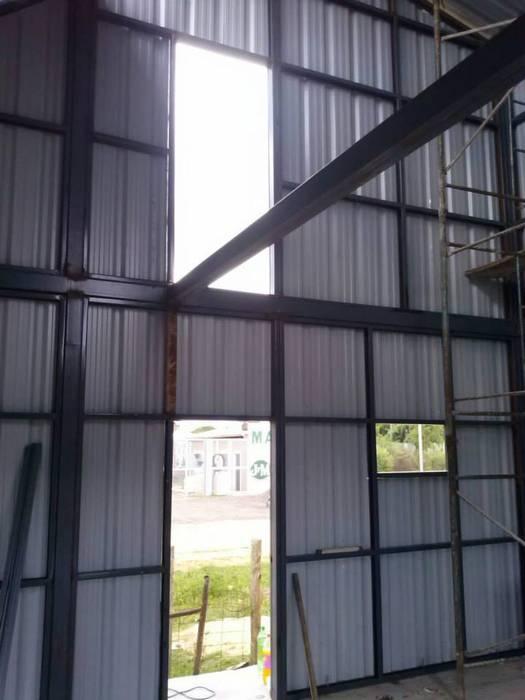 Dinding oleh FILIPPIS/DIP - DISEÑO Y CONSTRUCCION