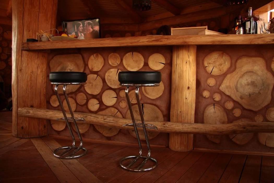 Bodegas de vino de estilo rústico de Organica Design & Build Rústico