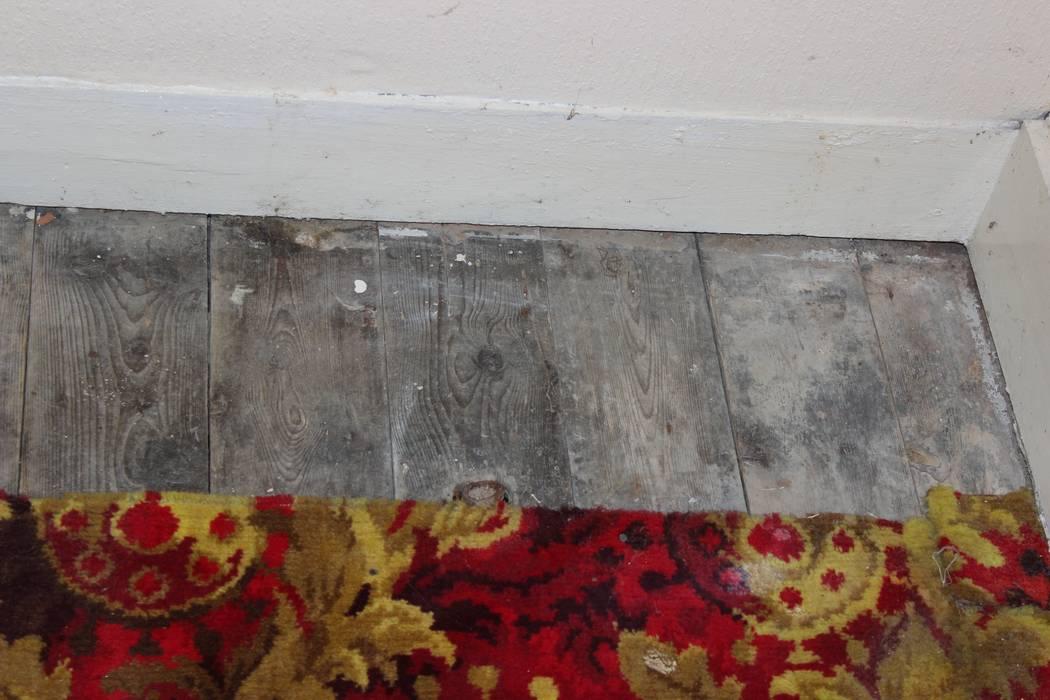 Lounge Before - unpolished floor boards Millennium Interior Designers