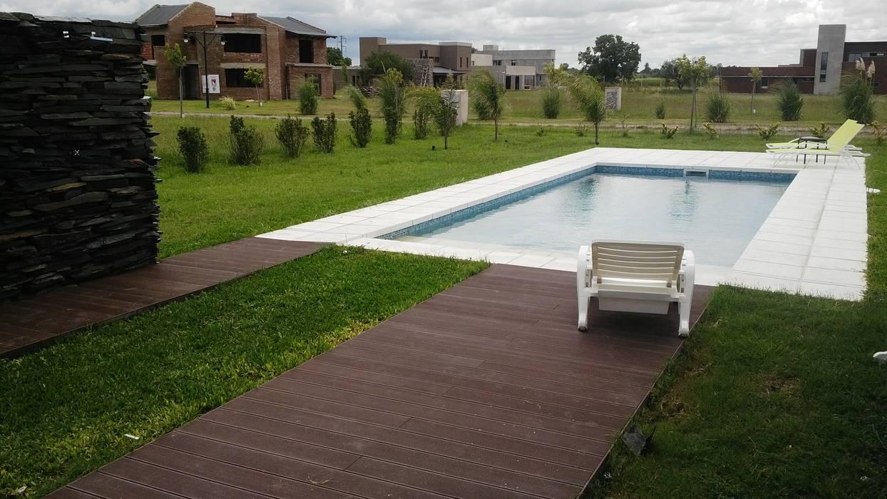 piscina en country: Piletas de estilo minimalista por VHA Arquitectura
