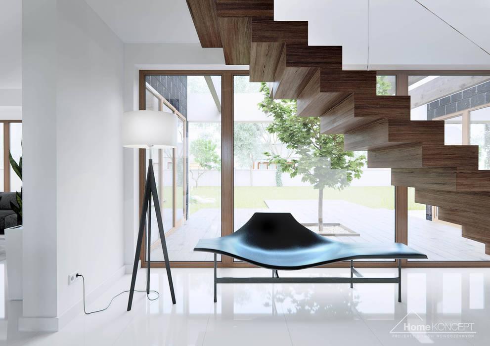 Коридор, прихожая и лестница в модерн стиле от HomeKONCEPT   Projekty Domów Nowoczesnych Модерн
