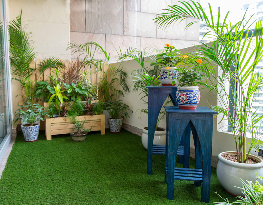 After - Accent tables add charm to the green space. Studio Earthbox Eclectic style balcony, veranda & terrace