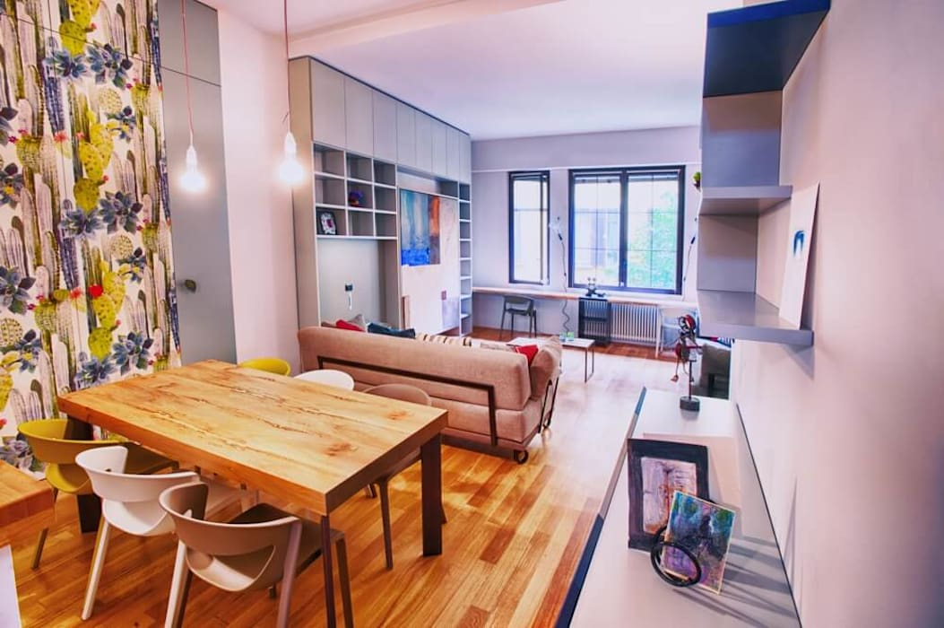 Vista sulla cucina e sul soggiorno: Sala da pranzo in stile in stile Eclettico di Dima snc di Maiocchi Dario e c.