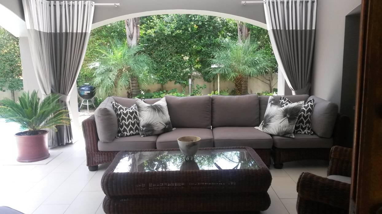 Balcones y terrazas de estilo ecléctico de CKW Lifestyle Associates PTY Ltd Ecléctico