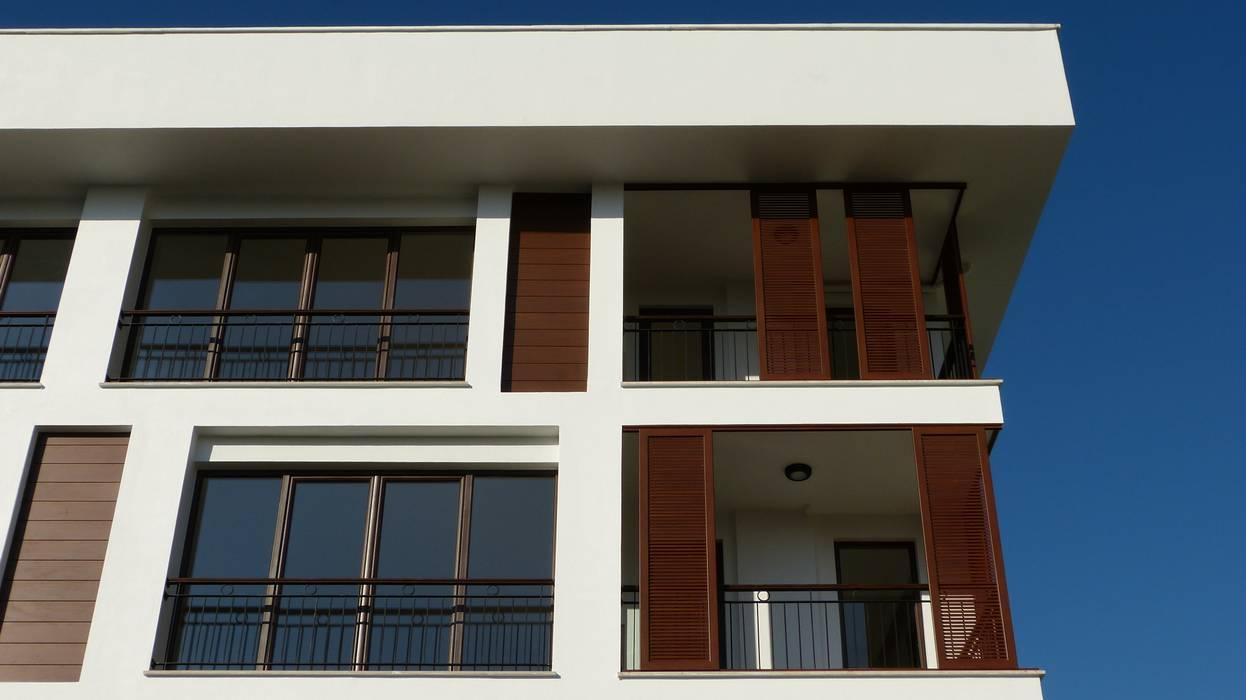 Дома в стиле модерн от yücel partners Модерн Дерево Эффект древесины