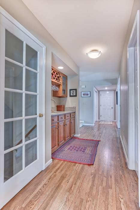 Homestead II Kitchen and Living Room:  Wine cellar by Studio Design LLC