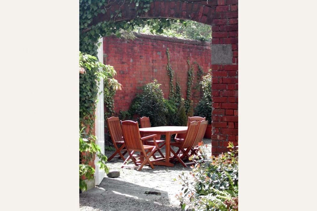 Reconstruction of Traditional Coach House Reusing Original Materials:  Garden by Des Ewing Residential Architects, Country