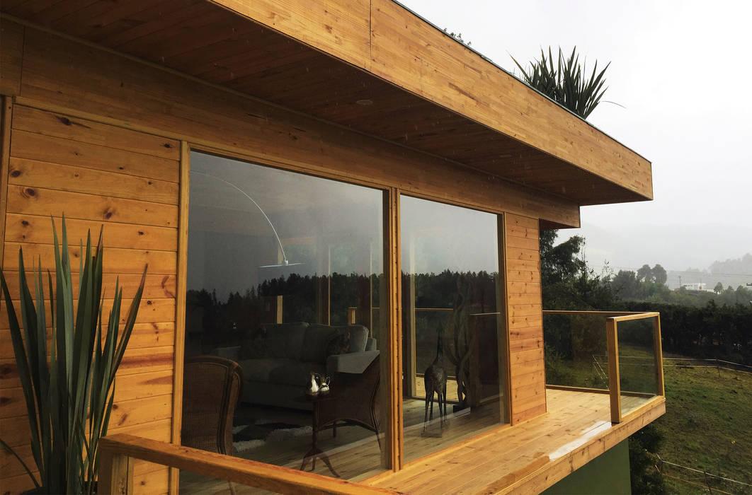 Unión de naturaleza y madera Casas de estilo moderno de Taller de Ensamble SAS Moderno Madera Acabado en madera