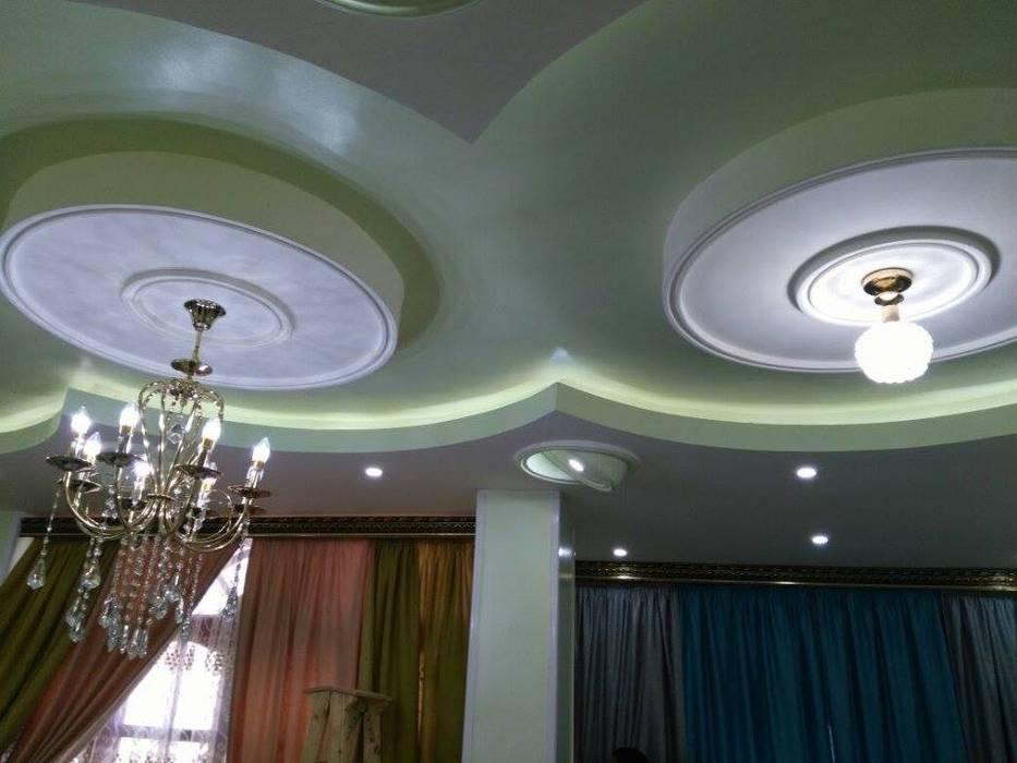 تشطيب شقة بالتجمع الخامس بالقاهرة الجديدة  مع شركة كاسل:  غرفة المعيشة تنفيذ كاسل للإستشارات الهندسية وأعمال الديكور في القاهرة